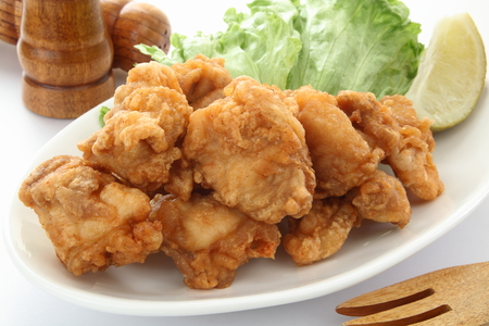 Fried Chicken with Salad and Lemon on White Background