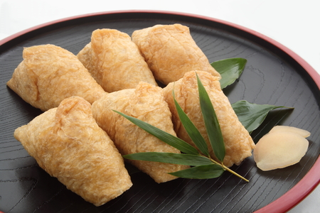 Inari Sushi Wrapped in Fried Tofu in Lunch Box, Japanese Food Stock Photo