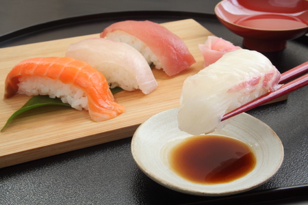Eating Sea Bream Sushi with Chopsticks, Japanese Food
