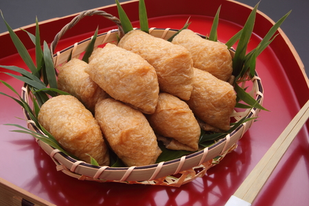 Inari Sushi; Vinegar-Ed Rice Wrapped in Fried Tofu in Bamboo Basket on lacquered tray, Japanese Food