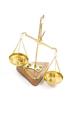 Scale of justice and two wedding rings Stock Photo - 7198099