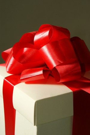 one white gift box with red ribbon  Stock Photo - 7509198