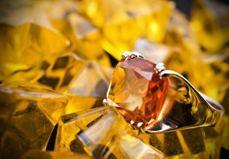 signet: retro old silver ring with orange gem and orange stones Stock Photo
