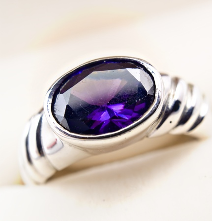 signet: retro old silver ring with blue gem in box isolated on a white  Stock Photo