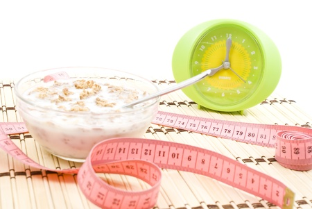 Muesli tighten with measure tape isolated on white  photo