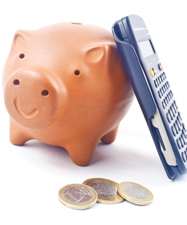 Piggy bank with calculator and coins Stock Photo