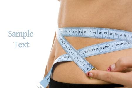 Close up of a measuring tape around slim beautiful waist Stock Photo - 11871461