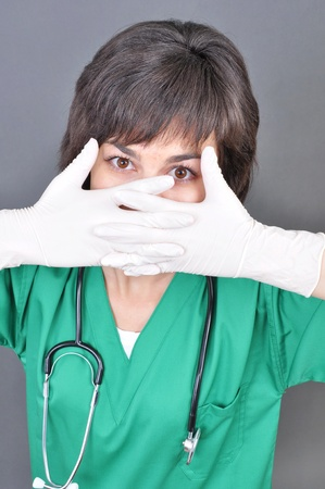 Doctor putting on white sterilized medical glove for making operation  photo