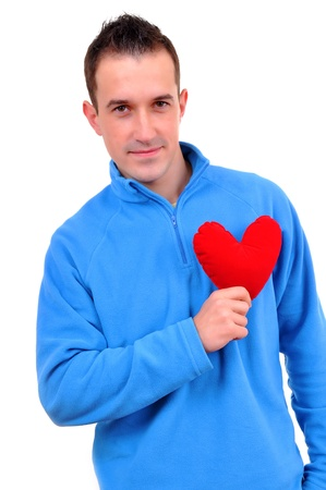 Young man holding heart  photo