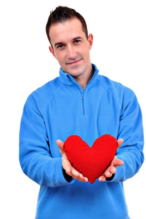 Young man holding heart Stock Photo - 12266729