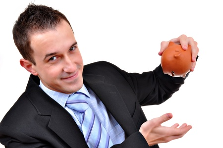 Business man staring at a piggy bank isolated  photo