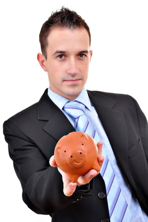 Attractive businessman holding piggy bank. All on white background  photo