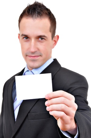 Young business man showing off his blank business card that is ready for text  photo