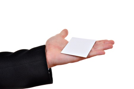 Paper card in man hand isolated on white background  photo
