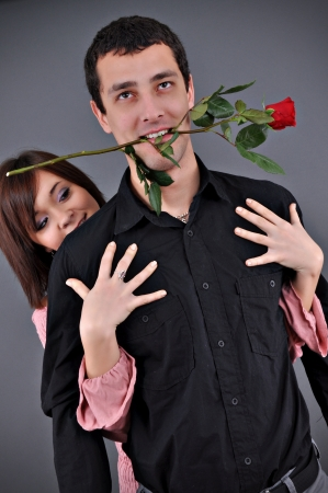 joyousness: happy couple rose in the mouth of the guy