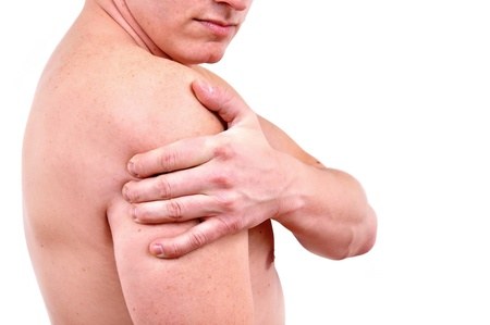 shoulder pain: Man holding on arm