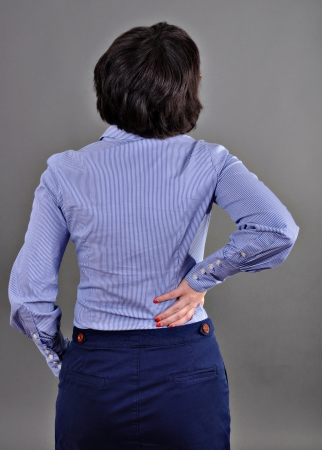 bend over: Business woman - Pain Stock Photo