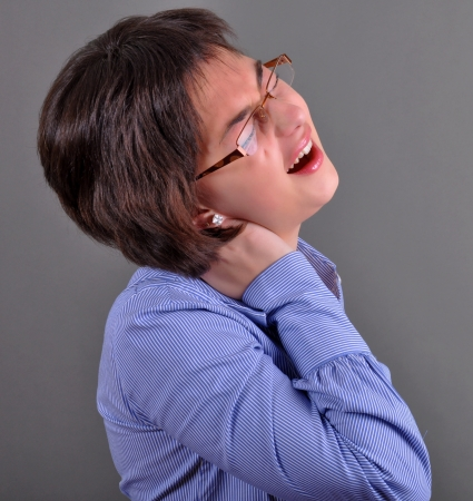 neck pain: Portrait of beautiful business woman with neck pain