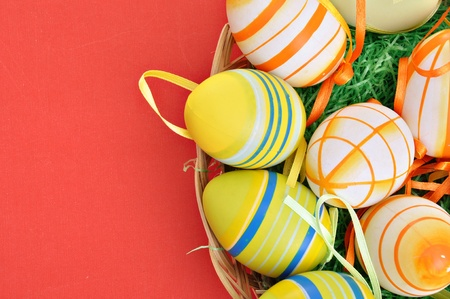 Colorful Easter Eggs basket set on red background  photo
