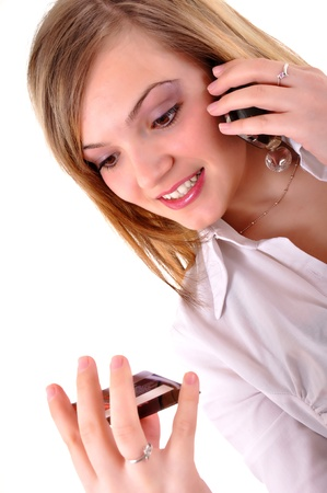Young woman with a credit card and making a call Stock Photo - 12267243