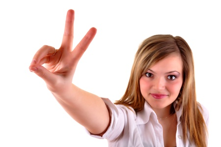 Young casual woman showing victory sign isolated on white background Stock Photo - 12266860