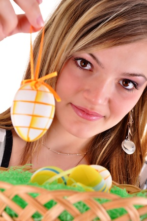 Young beautiful girl with easter egg in her hand  photo