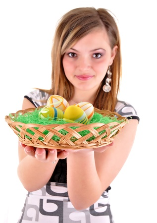 Young woman with easter eggs in a punnet  photo
