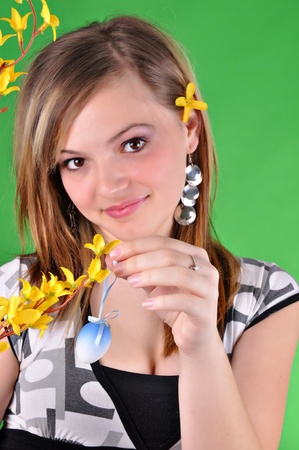 Young beautiful girl preparing for Easter  photo