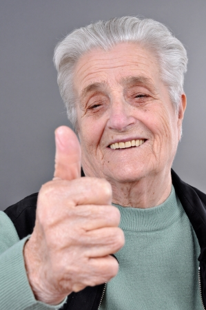 matron: Happy old woman with thumb up