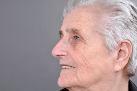matron: Old, attractive Caucasian woman looking off into the distance