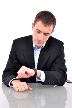 wait: business man looking at his watch over white  Stock Photo