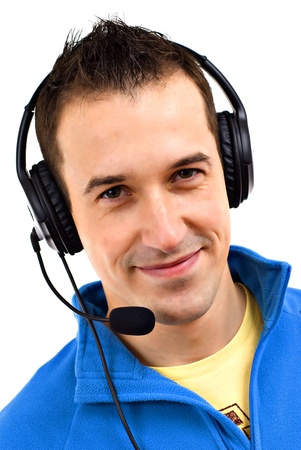 Young friendly man with headset on white background  photo