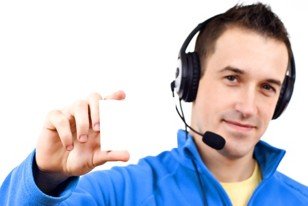 Young friendly man with headset on white background Stock Photo - 12267358