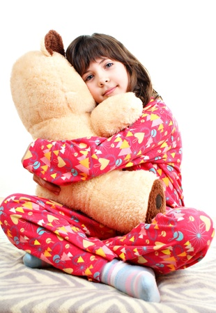 Little girl with toy bear isolated on a white background Stock Photo - 16305479