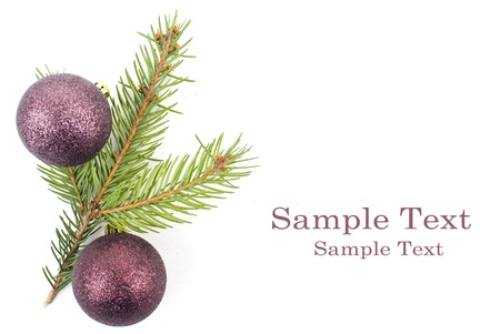 Closeup photo of a nice colorful Christmas decoration bauble hanging on Christmas tree. Isolated on white.  photo