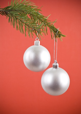 religious event: Closeup photo of a nice colorful Christmas decoration bauble hanging on Christmas tree. Isolated on white.