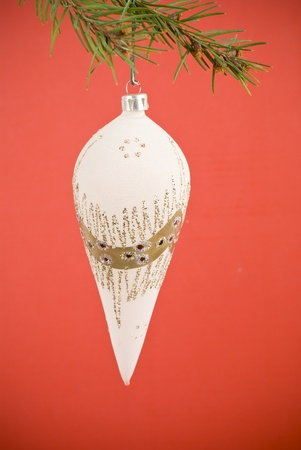 Closeup photo of a nice colorful Christmas decoration bauble hanging on Christmas tree. Isolated on white. Stock Photo - 12267382