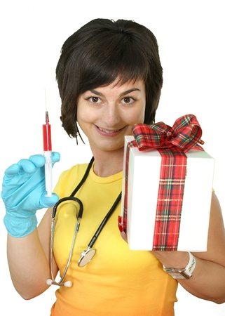 medical doctor with syringe and gift box on white background  photo