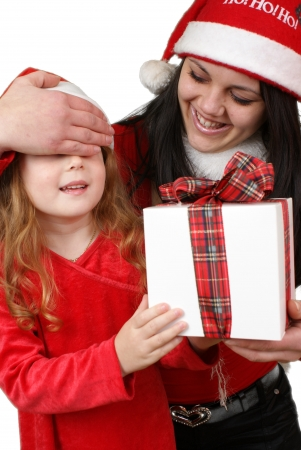 Little girl friend gives a holiday gift in red box with white ribbon. Stock Photo - 16305530