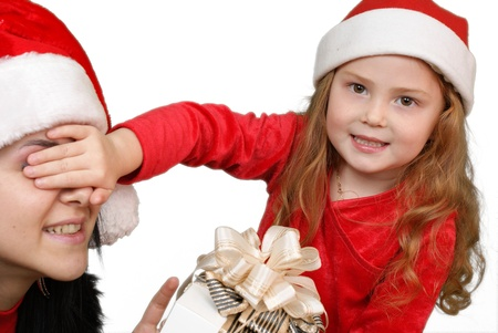 Little girl gives a holiday gift in red box with white ribbon   photo