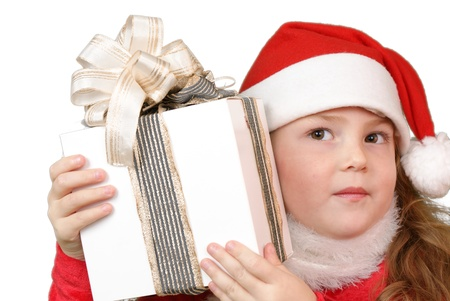Girl in christmas hat with gift Stock Photo - 16305525