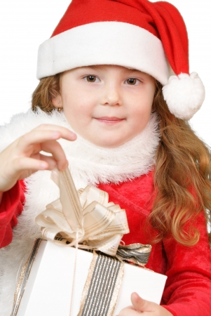 Girl in christmas hat opening a gift Stock Photo - 16305533