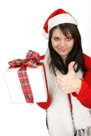Portrait of pretty young woman holding gift giving thumbs up isolated on white background