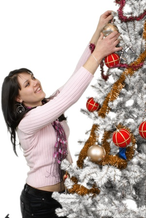 Girl decorating the christmas tree   Isolated   photo