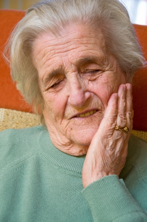 Senior woman with tooth pain photo