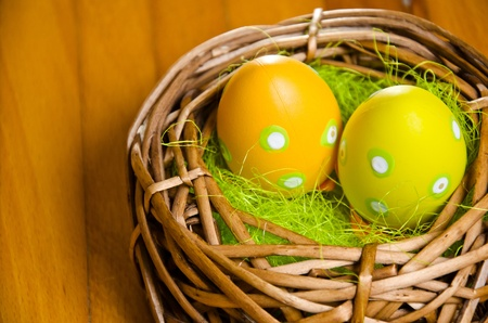 Colorful easter eggs on old wooden background  photo