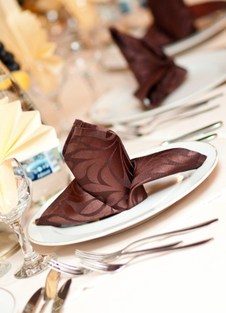 wedding table setting: catering table set service with silverware, napkin and glassware at restaurant  Stock Photo
