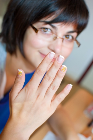 manicurist: Young woman at manicurist