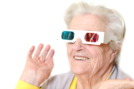 Senior woman wearing 3d glasses isolated on white background photo