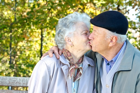 happy old man: Beautiful senior couple kissing Stock Photo